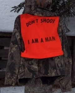 orange hunting vest with Don't Shoot I'm a Man printed on it